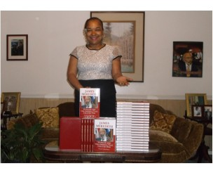 Meredith C. McGee displaying hardback & leather bound books
